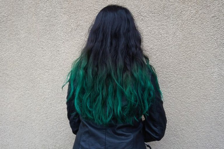 woman with dark green tips