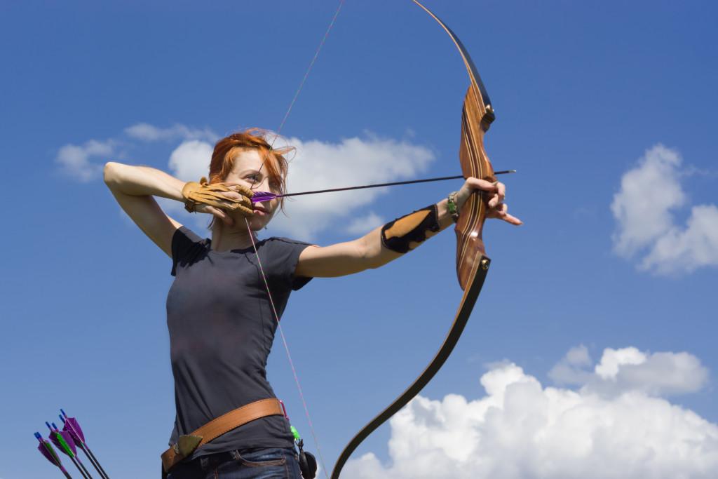 woman aiming an arrow