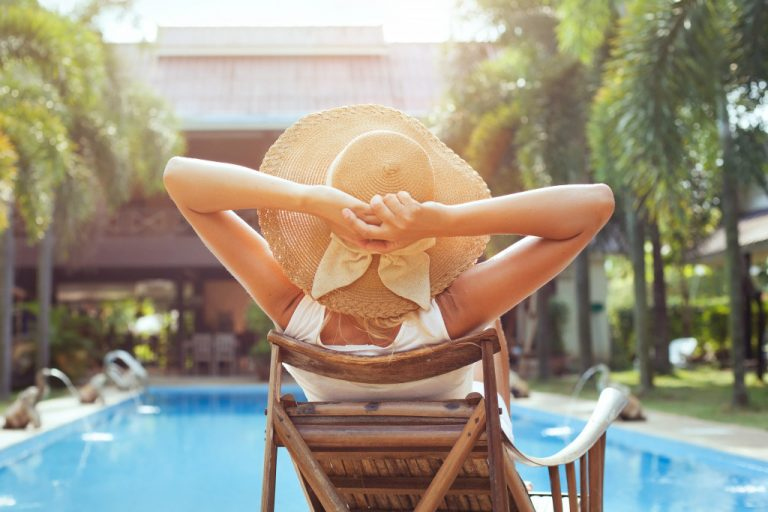 woman sitting by a pool